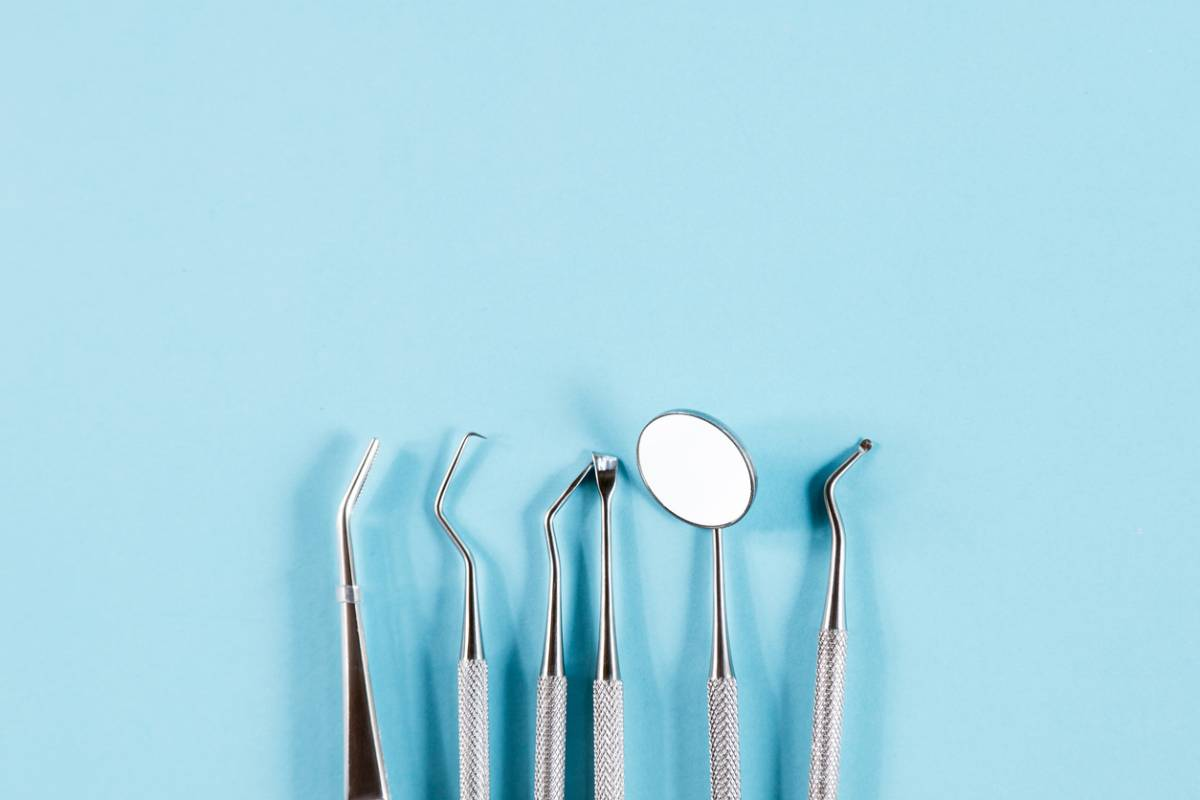 Lineup of dental tools used for oral health.